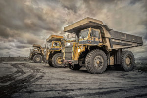 coal trucks stand ready to extract minerals