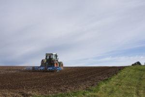 farmer drives a tractor